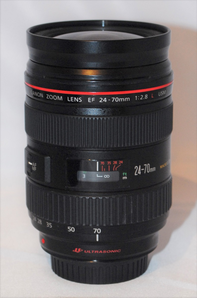 Canon 24-70mm f2.8 L lens. Includes hood. Excellent condition.