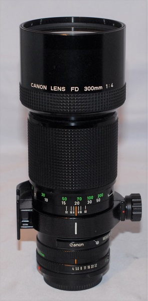 Canon 300mm f4 (Near mint condition. Includes red drop-in filter).