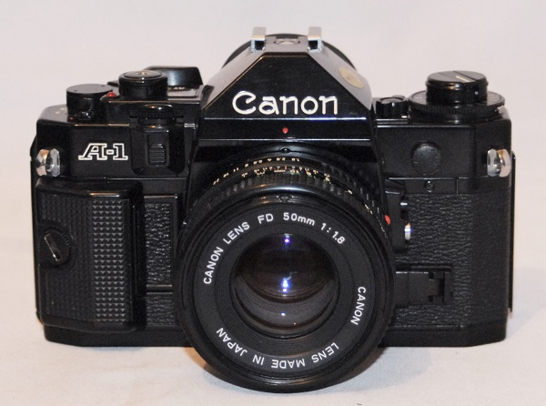 Canon A-1 + 50mm f1.8 lens. Excellent condition.