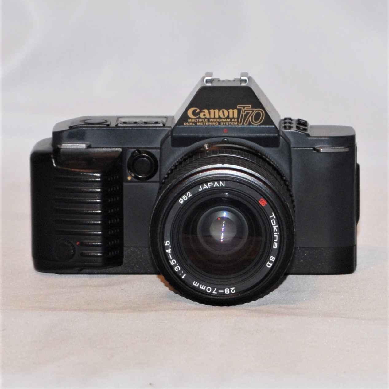 Canon T70 + Tokina SD 28-70mm f3.5-f4.5. Excellent condition.