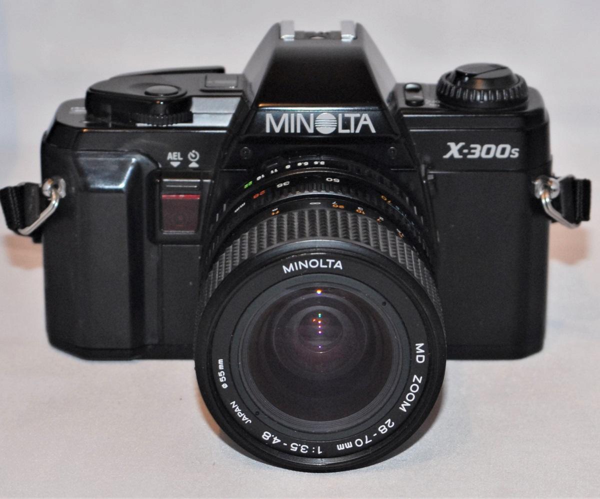 Minolta X-300s + 28-70mm f3.5-f4.8 lens. Excellent condition.