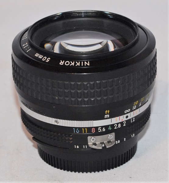 Nikkor 50mm f1.2. (AI mount. Includes hood. Excellent condition.)