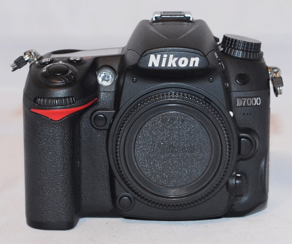Nikon D7000 (near mint condition).