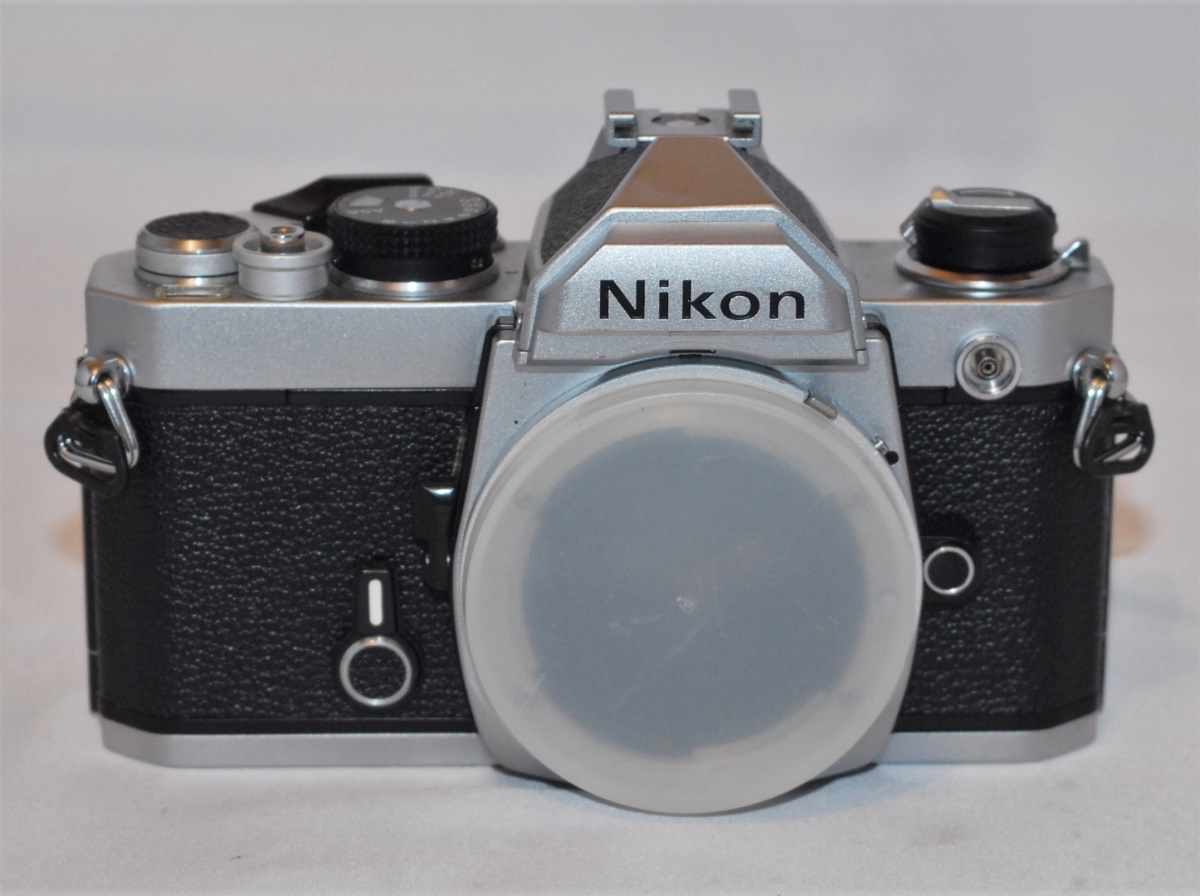 Nikon FM. Focusing screen has slight mark. Does not effect use. SOLD