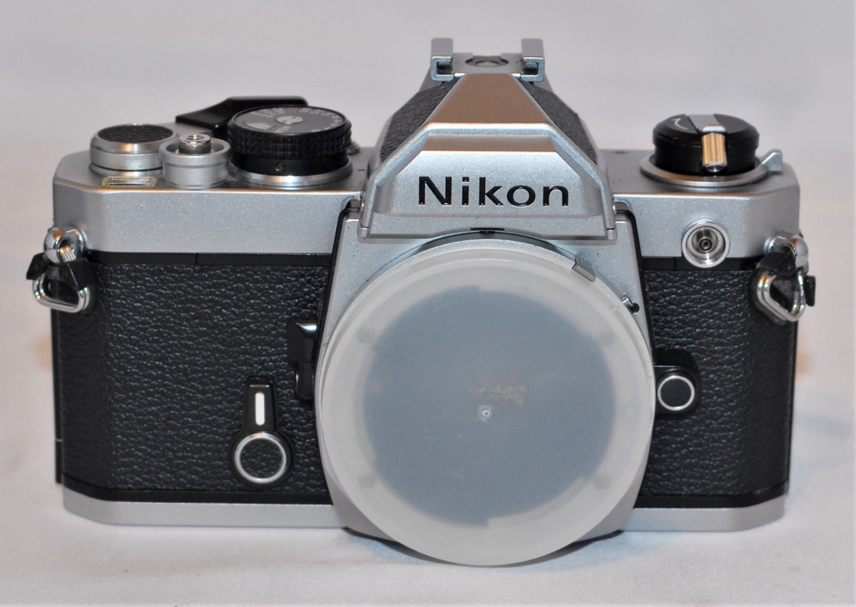 Nikon FM. Focusing screen has slight mark. Does not effect use. (SOLD)