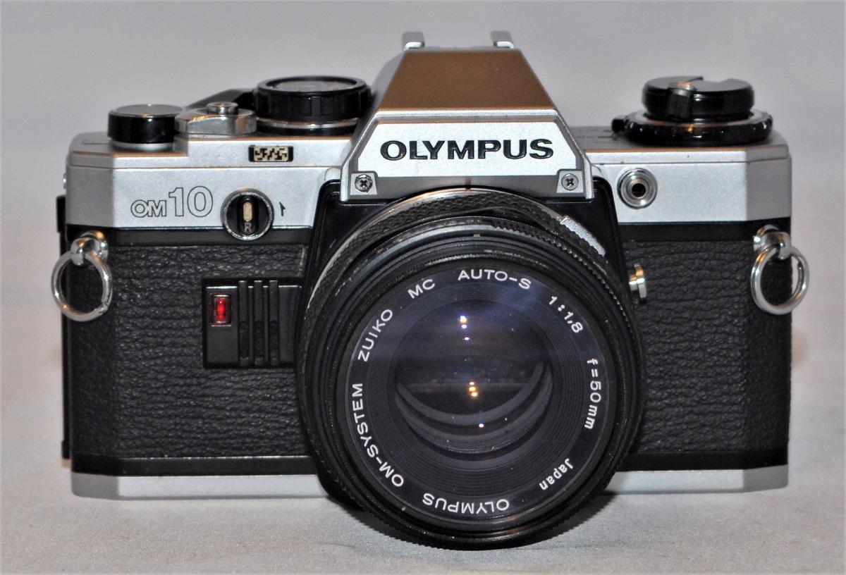 Olympus OM10 + 50mm f1.8 MC Zuiko lens. Excellent condition.