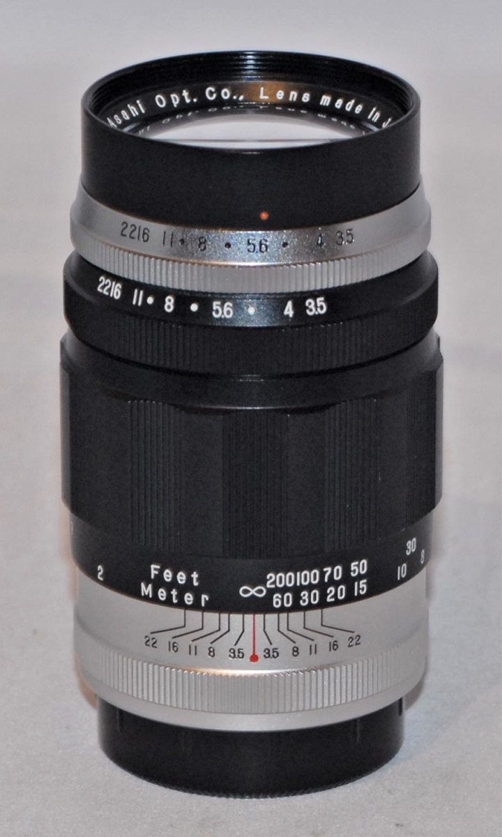 Pentax 135mm f3.5 preset lens. M42 mount. Comes with case.