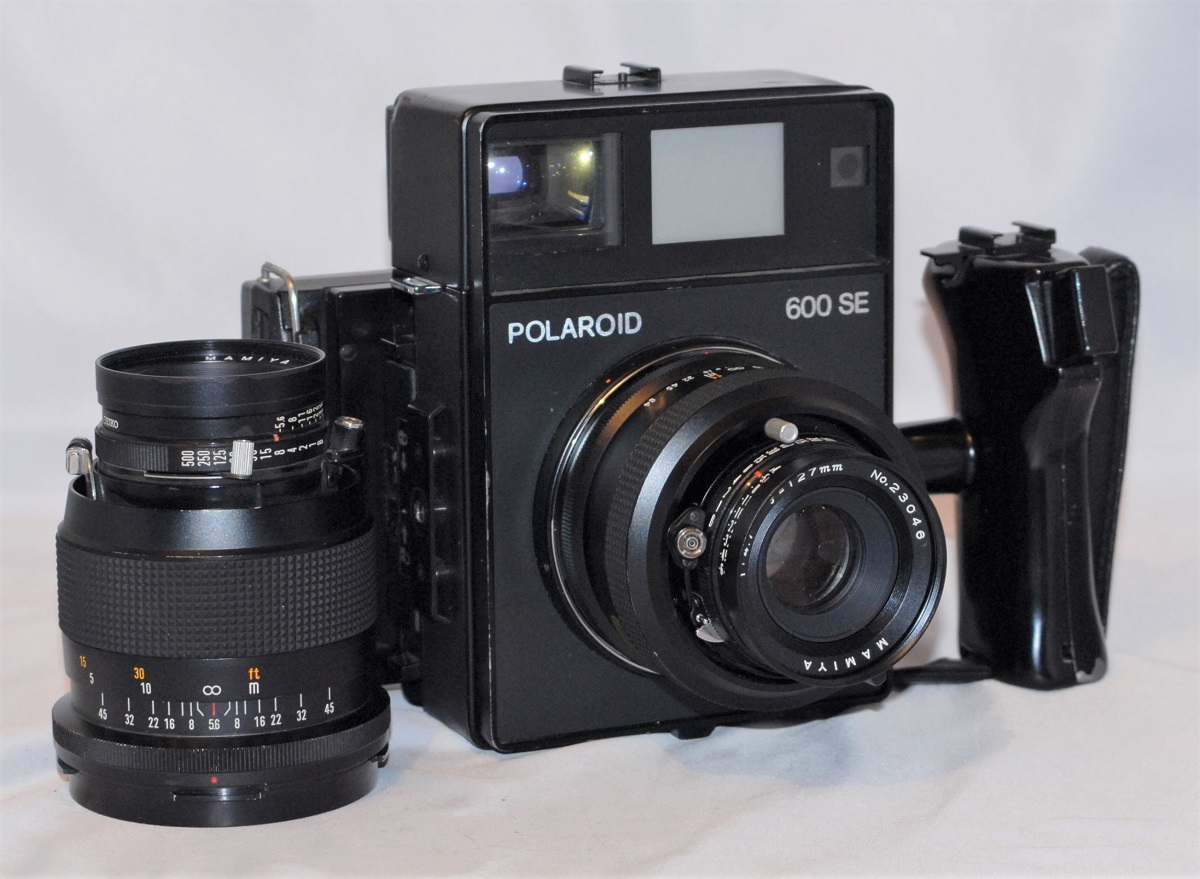 Polaroid 600 SE + 127mm f4.7 lens + 150mm f5.6 lens. Excellent condition.(SOLD)